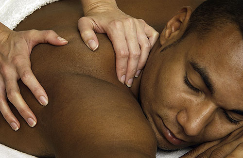 Man receiving a massage at the Interlude Spa