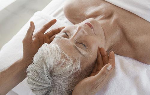 Older woman receiving a spa facial